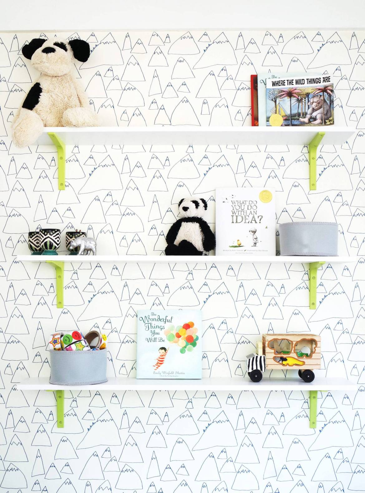 Pops of lime green pair will illustrative wallpaper create the perfect playroom. Click through to see the full reveal!