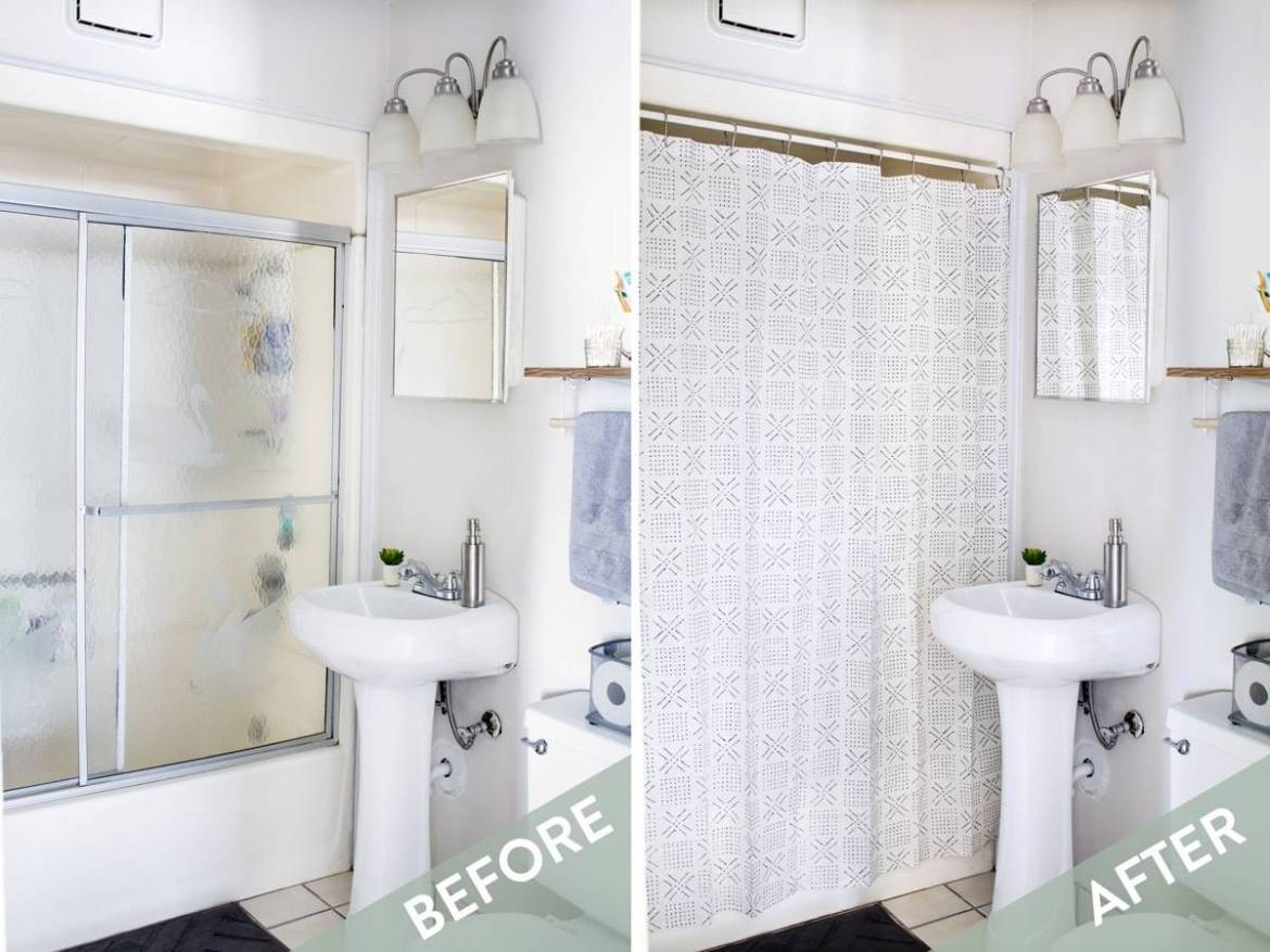 Curtain hung over glass shower doors