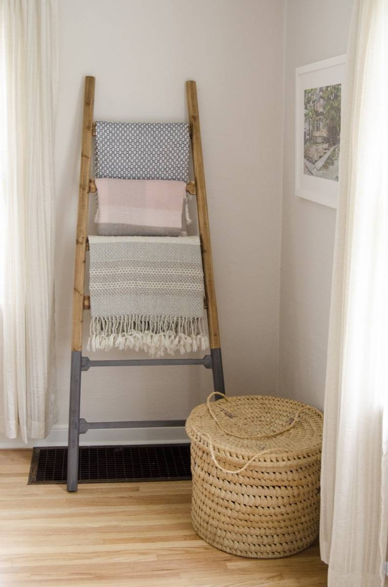 Blanket ladder with mid century modern chair and basket