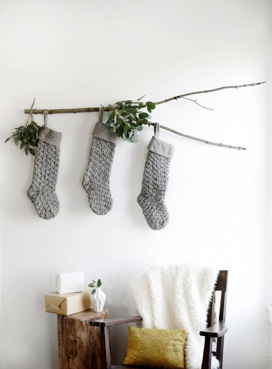 Christmas stockings hanging from a branch
