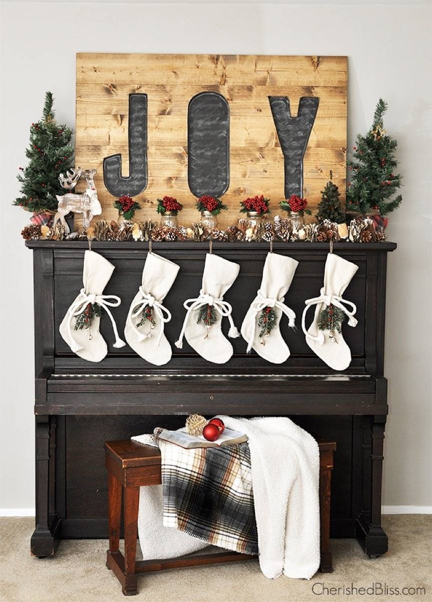 using a piano as a mantel to hang stockings