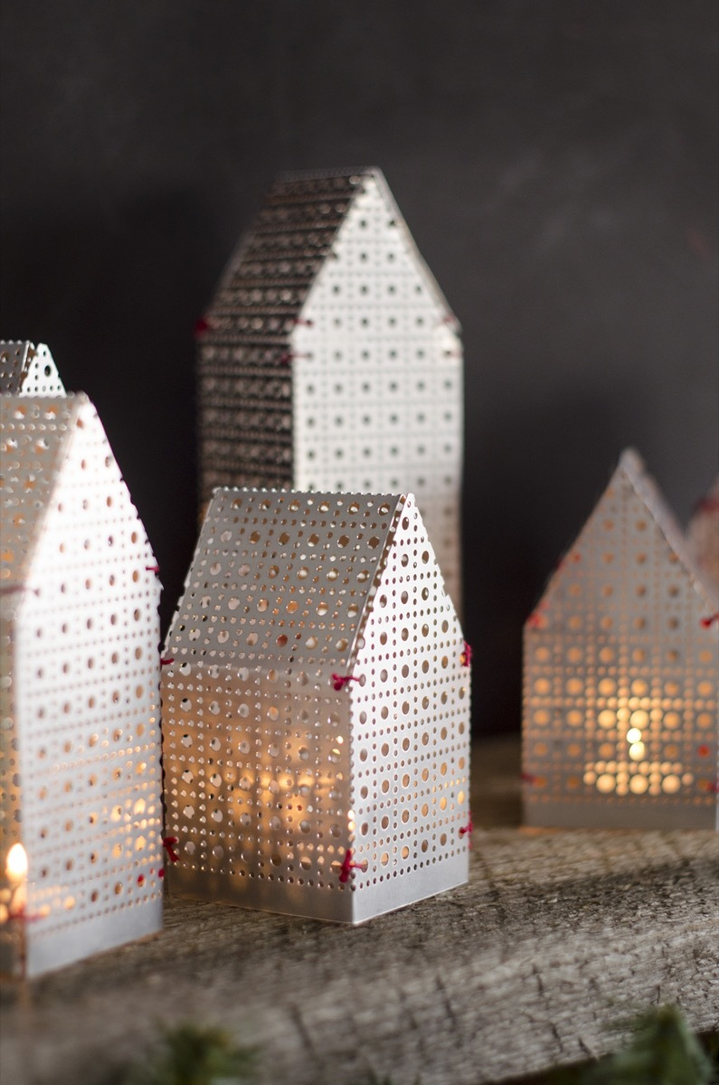 DIY holiday luminaries made from an aluminum sheet and thread
