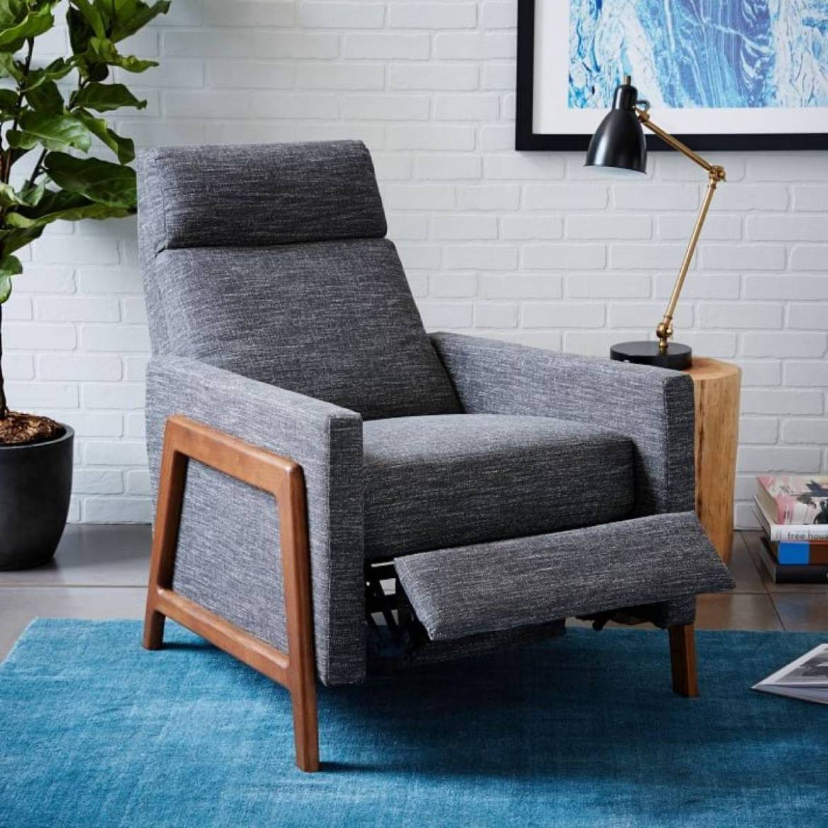 Get back pain relief from a recliner, like this gray one from West Elm