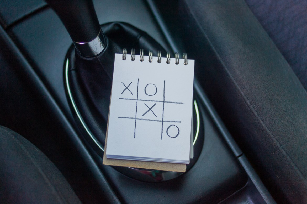 Road trip games: playing tic-tac-toe in the car.