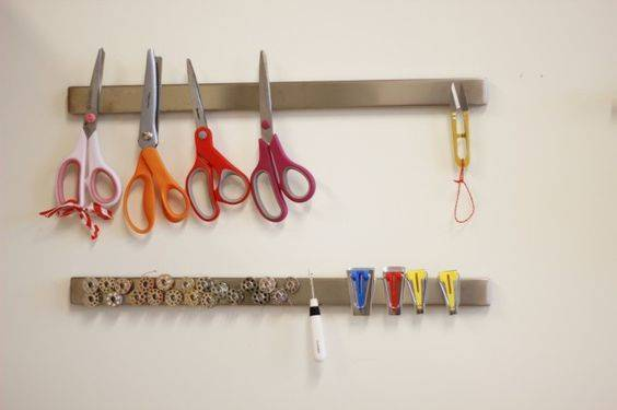 Store sewing tools and notions on a magnetic knife strip