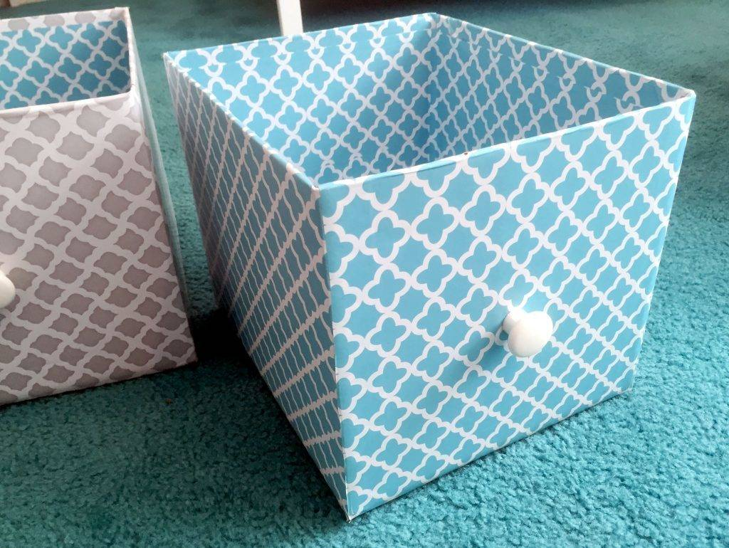 Cardboard boxes covered with contact paper