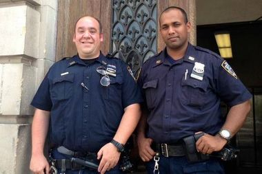 Officers Scott Nieri (left) and Gobin Raghunath, of the 103rd Precinct, saved an infant who choked on an apple.