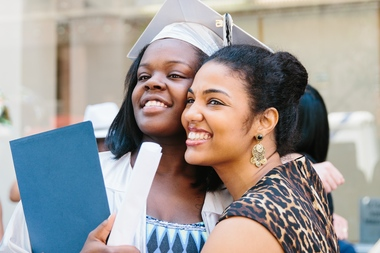 Monei Thompson at graduation in June from Brownsville's Brooklyn Democracy Academy with her advocate counselor Tashawnee Guarriello.