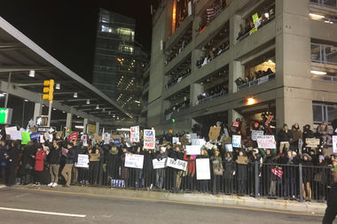 Protesters gathered at JFK Airport on Saturday after dozens of people were held there following President Donald Trump's executive order restricting immigration and refugees from predominantly Muslim countries.