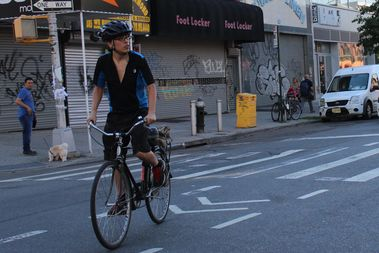 A cyclist rides down a newly painted bike lane on Knickerbocker Avenue.