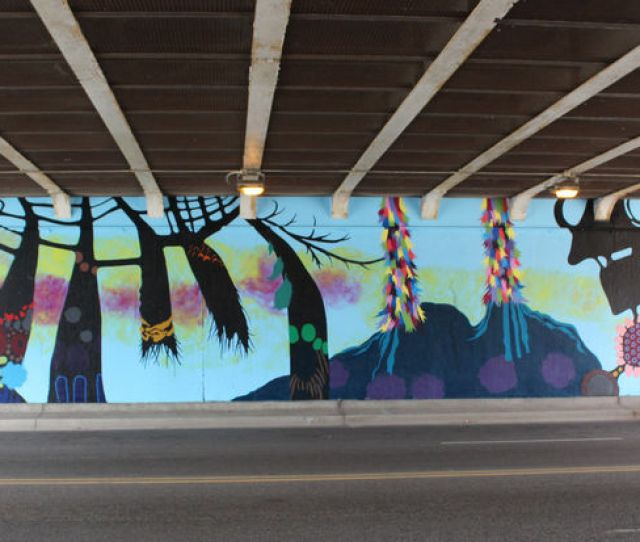 Artist Renee Robbins Is Putting The Finishing Touches On Murals At The Fullerton Underpass At Lake