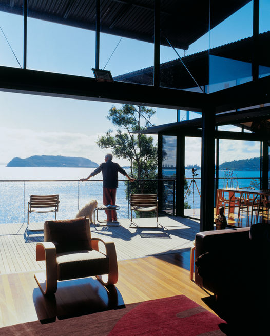 <br /><br /><br /><br /><br /> The owner of a hillside home overlooking Australia's Pittwater Bay takes in a panoramic view of the ocean from his balcony. Photo by: Richard Powers<br /><br /><br /><br /><br />