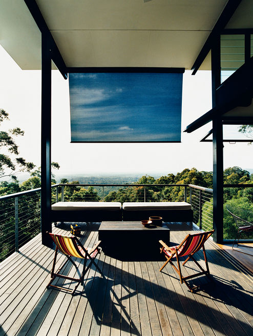 <br /><br /><br /><br /><br /> A couple's dream home in northeast Australia features a large deck off the living room that overlooks the hills of Noosa and the Pacific Ocean beyond. Photo by: Richard Powers<br /><br /><br /><br /><br />