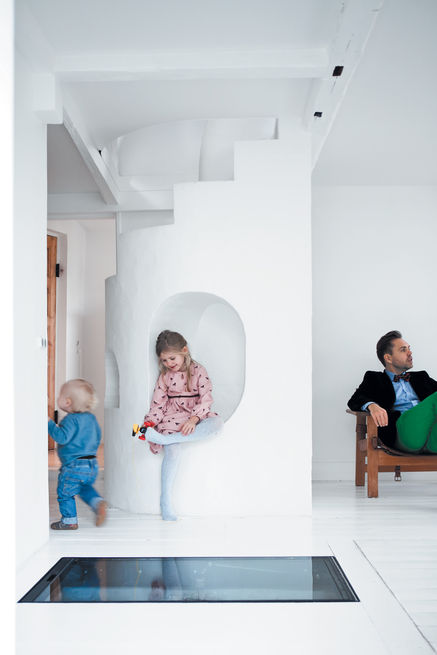 Small nooks and crannies enliven any space and let imagination run wild. In this cottage outside Copenhagen, Maja, 6, and Carl, 20 months, play in a sculpturally carved staircase. Photo by Jonas Bjerre-Polsen.  Photo by: Jonas Bjerre-Polsen