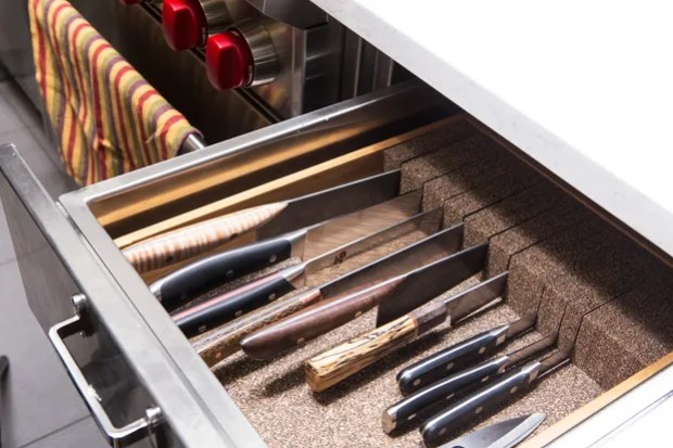 knives should be stored in a drawer close to the sink and dishwasher
