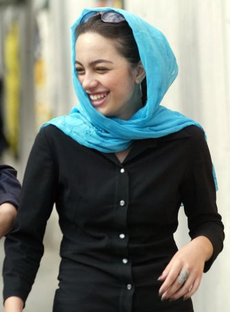 An Iranian woman laughs as she walks around the northern rich area of Tehran.