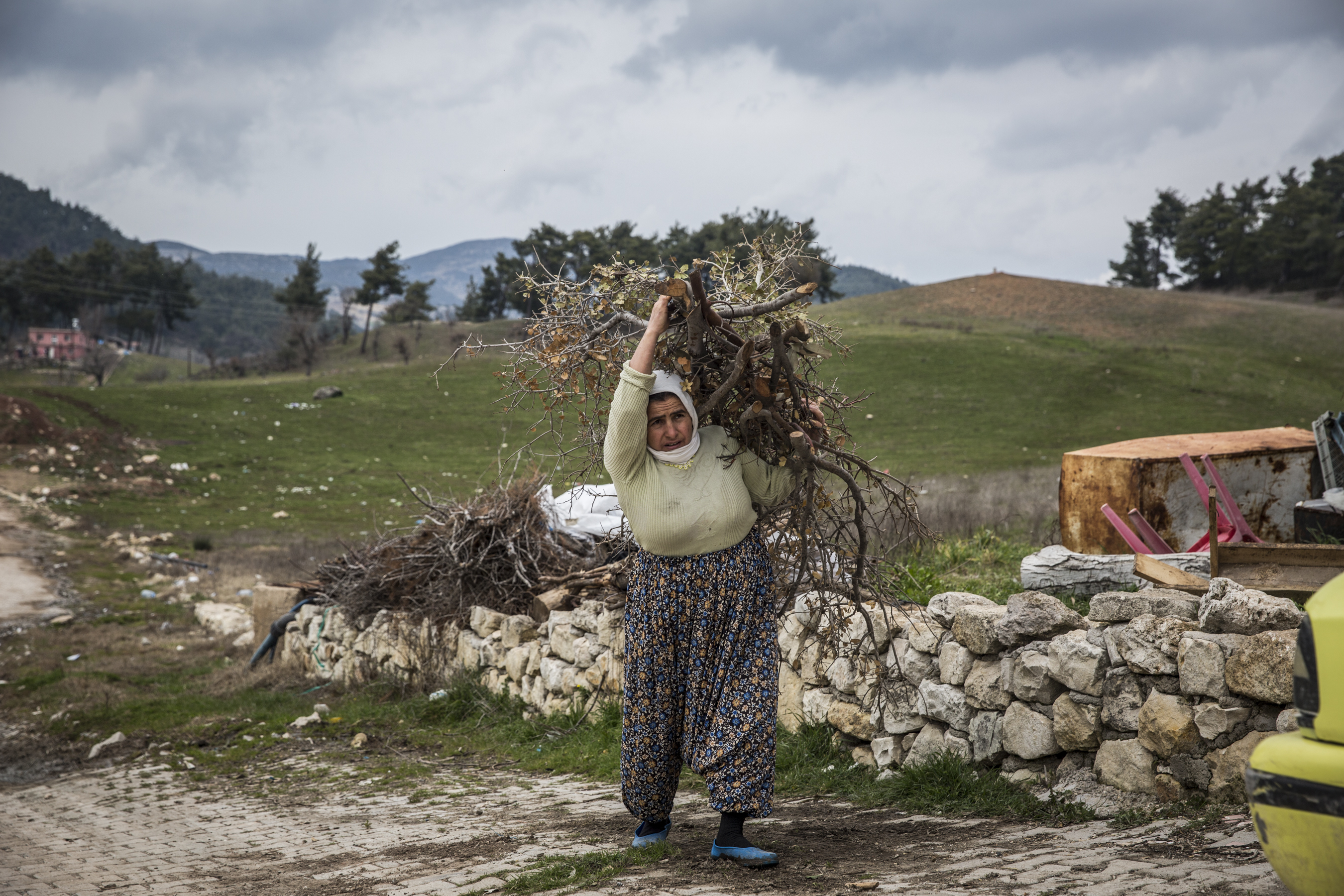 Woman carries firewood