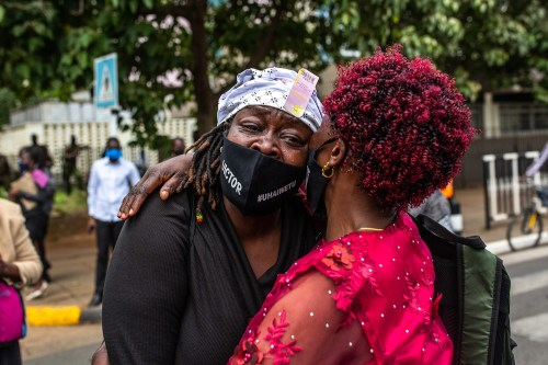 Mothers whose sons were killed by Kenyan police gather in front of Kenya's parliament