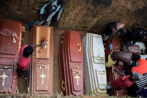 Victims of a massacre last year in the outskirts of Bunia are laid to rest in a mass grave.