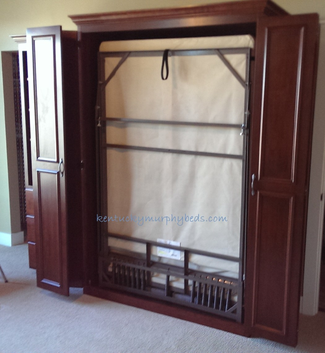 Queen size cherry Murphy bed with one bookcase, raised door trim, in a condominium