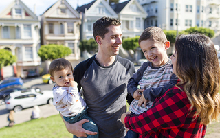 A family play in at a park in a suburban neighborhood in San Fransisco