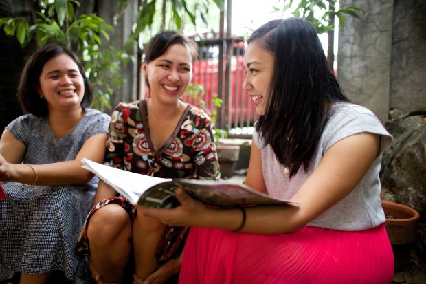 Filipino women participating in ministering.