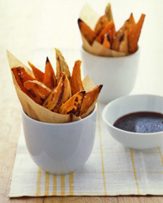 Thick, oven-baked sweet potato wedges are a great appetizer for any casual party. An easy dipping sauce made from soy sauce, rice-wine vinegar, and toasted sesame oil makes the sweet potatoes especially irresistible.
