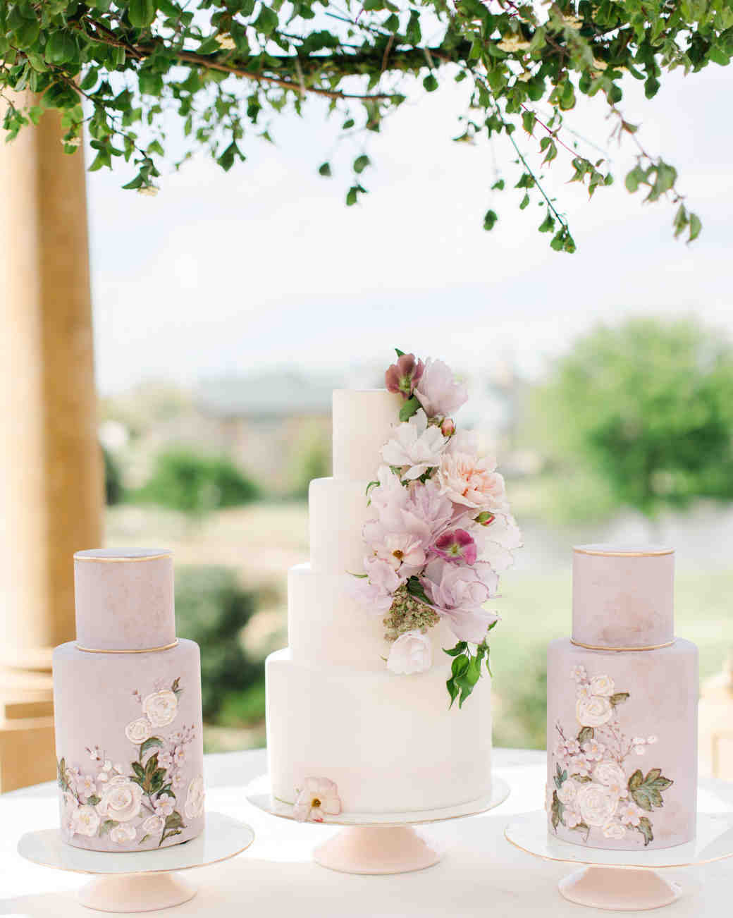 25 New Takes on Traditional Wedding Cake Flavors   Martha Stewart     three lavender wedding cakes with flowers