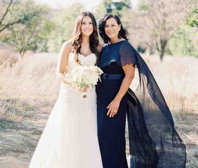 An Outdoor Photo Of A Mother And Bride