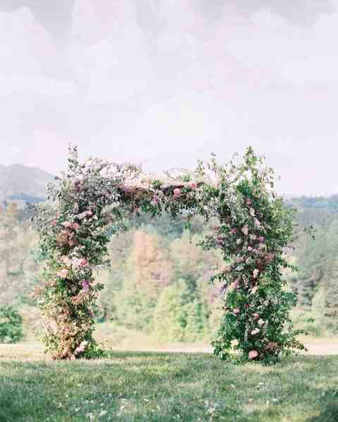 59 Wedding Arches That Will Instantly Upgrade Your Ceremony   Martha     Floral Wedding Arch with Pink Flowers and Lush Greenery