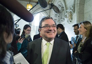 Finance Minister Jim Flaherty speaks with reporters as he leaves question period in the House of Commons on Parliament Hill in Ottawa on Thursday, March 6, 2014. Flaherty says he is leaving the federal cabinet and returning to the private sector.THE CANADIAN PRESS/Justin Tang