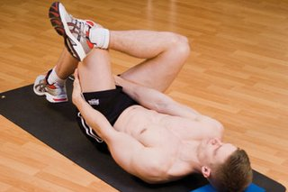 Picture of a man performing a lying deep gluteal stretch