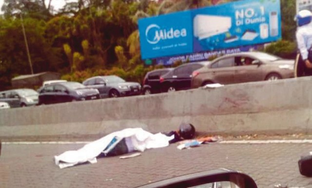 Image result for A teenage boy who was knocked down in a traffic accident in Johor Baru, Malaysia, was robbed of his mobile phone
