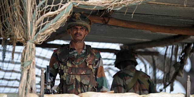 Indian soldiers take up position at an outpost on the India-Pakistan border in R.S. Pora, southwest of Jammu, on Oct. 2, 2016. (Tauseef Mustafa/AFP/Getty Images)