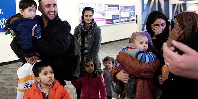 Mohammad Mobin smiles on Feb. 1 after greeting his sister's family, who had arrived as refugees from Afghanistan at an air base near Omaha, Nebraska. (Megan Farmer/Omaha World-Herald via AP)