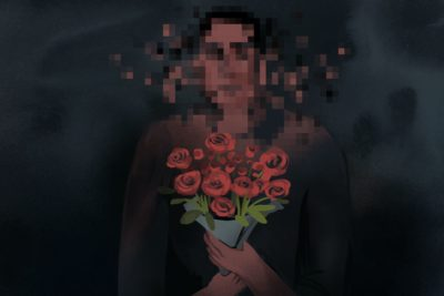Person holding bouquet of flowers, with face blurred.