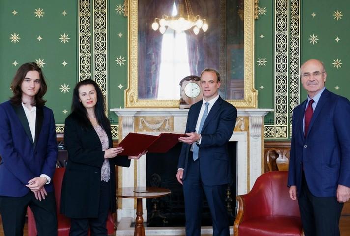 Foreign Secretary with Natalia and Nikita Magnitsky, and Bill Browder