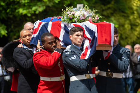 Military personnel from all three services carry the coffin of Dame Vera Lynn into her funeral service