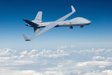 Image depicts the Protector aircraft flying in a blue sky.