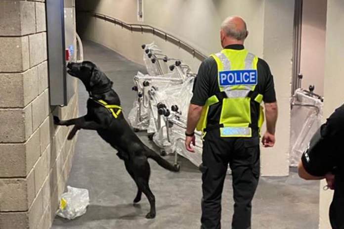 Police dog and handler working with Police Scotland during National Canine Training Exercise at Scottish Event Campus ahead of COP26