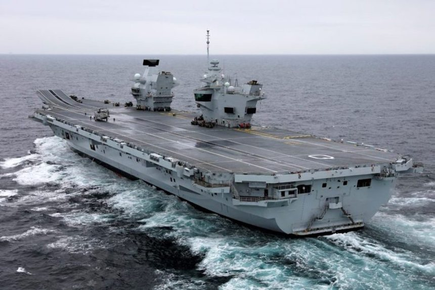 The Defence Secretary landed by Merlin helicopter on the deck of HMS Queen Elizabeth.