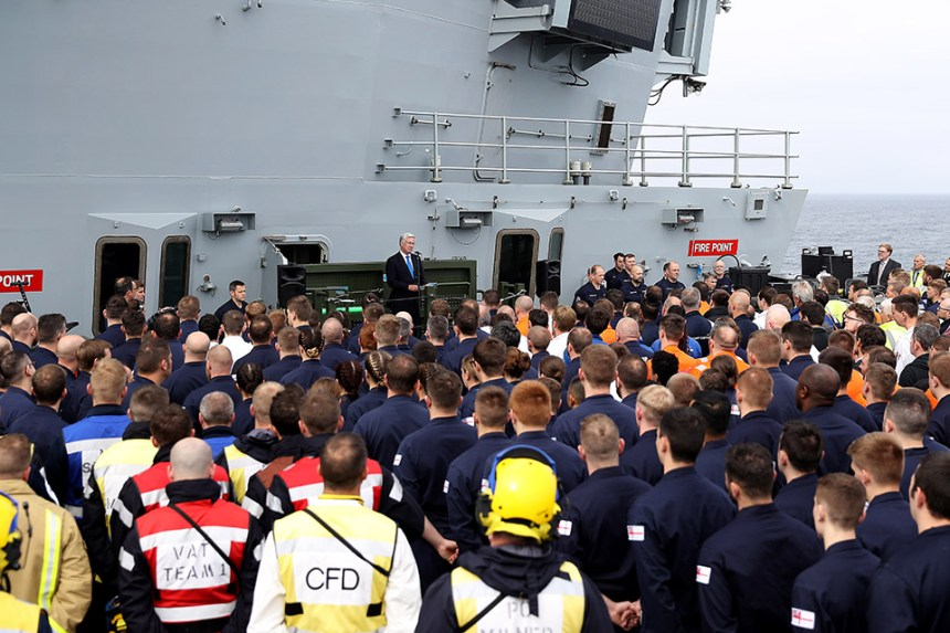 Sir Michael Fallon addresses the crew onboard HMS Queen Elizabeth, the Royal Navy's newest aircraft carrier and future flagship