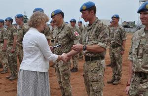 HMA Alison Blackburne presents commander Lt Col Jason Ainley with his UNMISS medal in Juba.