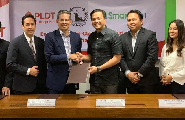 PARTNERSHIP. Deputy House Speaker and PNFPP founding director Mikee Romero (third from left) and PLDT chief revenue officer Al Panlilio (second from left) seal the agreement to install free Wi-Fi at the Miguel Romero Field during the SEA Games. Also shown (from left) are ePLDT president Jovy Hernandez, AirAsia executive Erick Arejola and polo competition manager Camila Lastrilla.