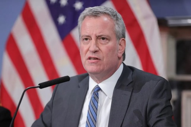 De Blasio says officer who pulled gun on protesters should be fired. Then a full video of incident surfaced.