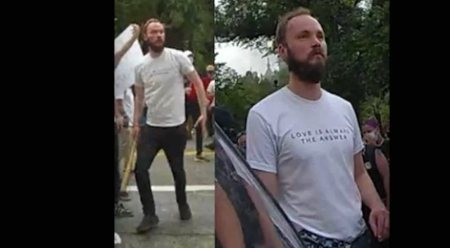 Rioter wearing 'Love Is Always the Answer' T-shirt accused of bashing cop in head with baseball bat