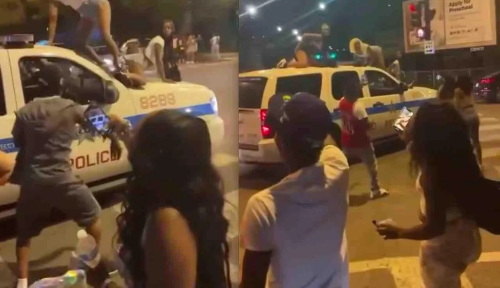VIDEO: Women twerk atop Chicago police SUV while it's moving. Cops say they're investigating; observers say it's disgusting.