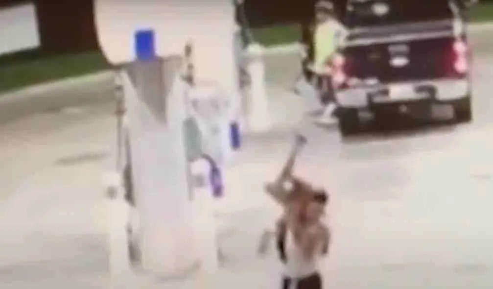 WATCH: Kidnapper chases female, drags her out from under vehicle, carries her over his shoulder and drives off with her — and bystander feet away does nothing