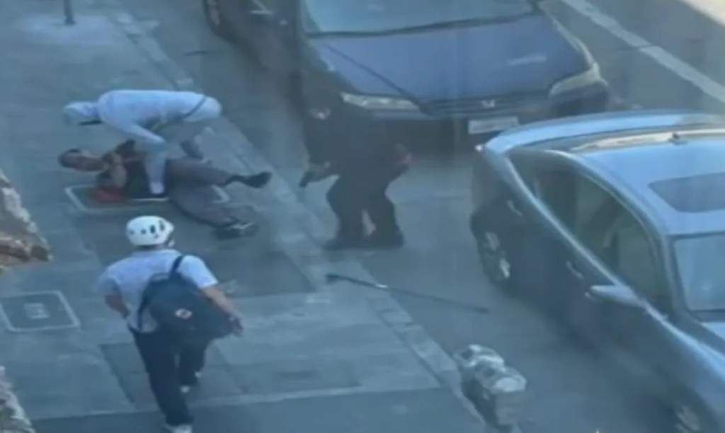 Terrifying video shows moment Good Samaritan is pistol-whipped trying to stop robbers from battering elderly Asian man