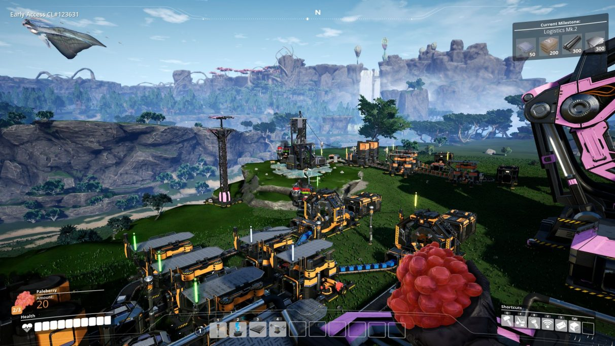 A screenshot showing a fairly extensive factory starting to grow across the beautiful landscape in Satisfactory